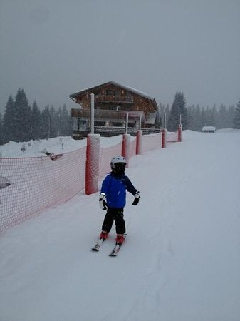 skiing down to lesson meeting point from the altitude lodge