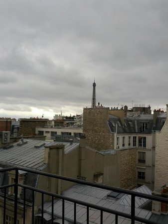 Hotel Keppler:                   A top-floor view of the Eiffel Tower, from the room's balcony.               