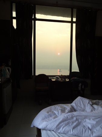 A Palace on the River, Rashmi Guest House:                   my deluxe river facing room at sunrise