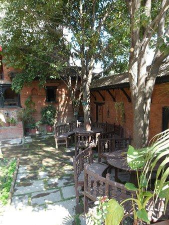 Kantipur Temple House: front garden seats