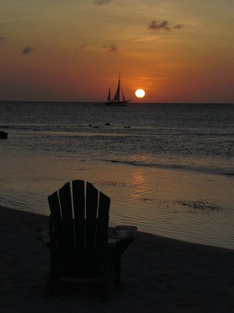 Sunset Beach Bistro: You could be seated in this chair watching a beautiful sunset!