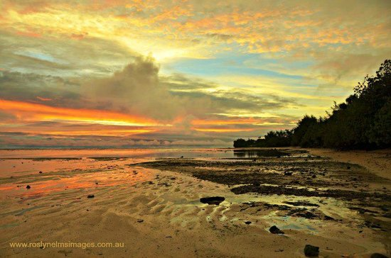 Sea Change Villas:                   Sunset from the beach outside at low tide - stunning!