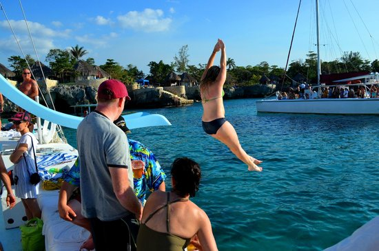 Couples Swept Away:                   water slide on sunset catamaran cruise