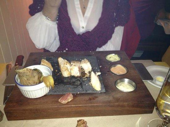 C'est la Vie:                   Cooking her chicken (volaille) on a lava rock.