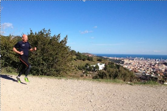 Running Tours Barcelona:                   View of Barcelona from mountain trail - running tour with Robin