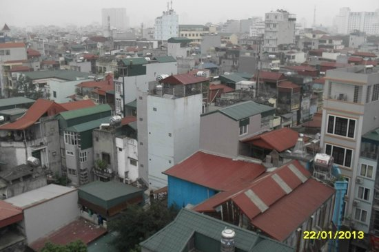 Hanoi View 2 Hotel :                   Hanoi skyline. Whatever happened to the building regulations ?