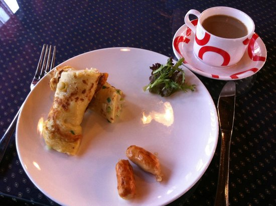 """Jingshan Garden Hotel:                                     """"omelette"""" (more like an eggy crepe) with sausage and coffee"""