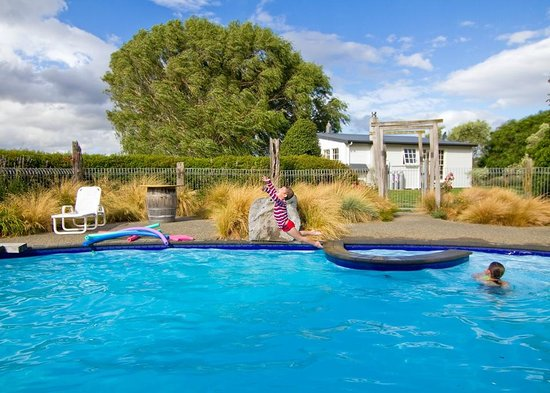 St Leonards Vineyard Cottages:                   The Woolshed viewed from the swimming pool
