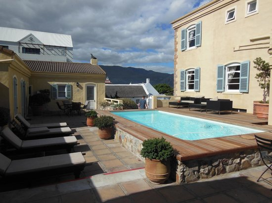 Auberge Burgundy:                   Pool towels provided with several lounge chairs and outdoor couches.