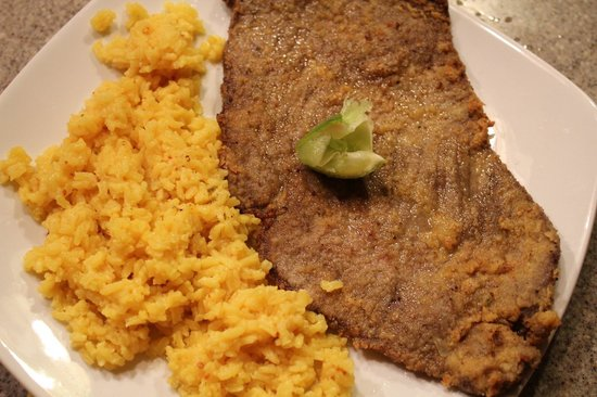 Mad Cuban Cafe: Yellow rice & breaded steak