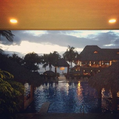 Flamingo Beach Resort & Spa :                   The view of the pool and restaurant from across the lobby.