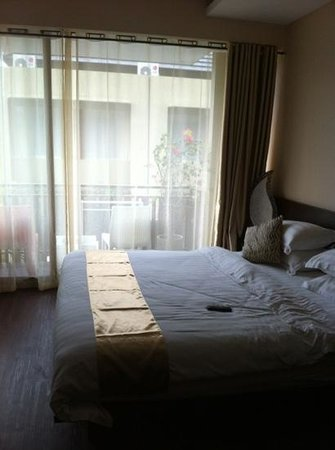 Devata Suites and Residence:                   A big spacious bedroom