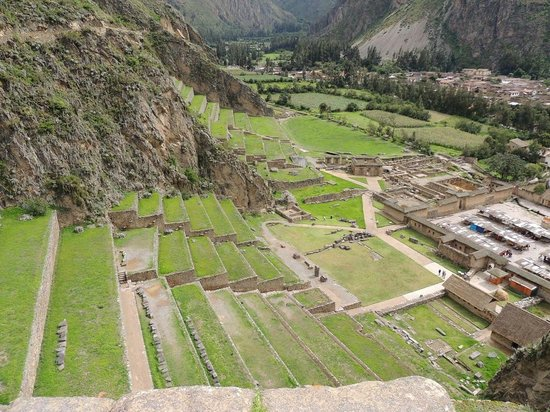 Lower portions of ruins and Old Ollantaytambo in the background as you look up
