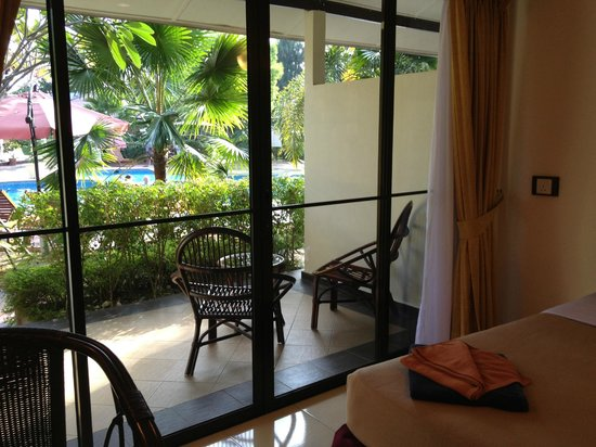 Pangkor Sandy Beach Resort:                   View of room terrace & pool from inside room