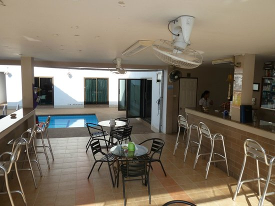 The Englishman's Retreat Guesthouse & Resort:                                     The reception and restaurant area, with the pool and a coupl