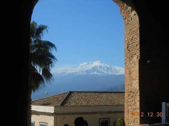 Greek Amphitheater :                   Snow covered Etna from Greek Theater, Taormina, Sicily