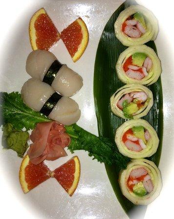 Sakura Japanese:                   Sushi roll and scallop nigiri