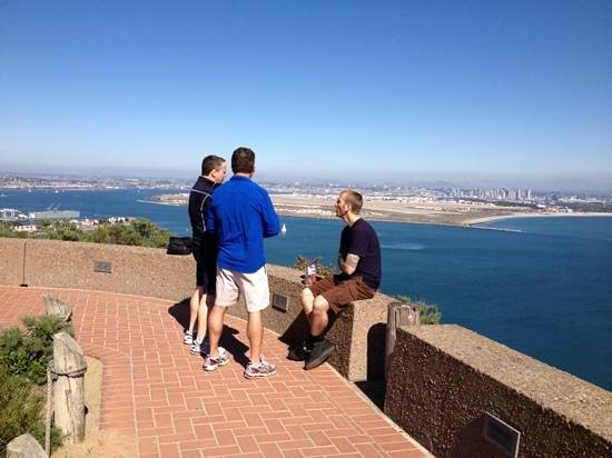 The Bike Revolution Private Tours:                   Matt, our guide, with the guys at the Cabrillo Monument!