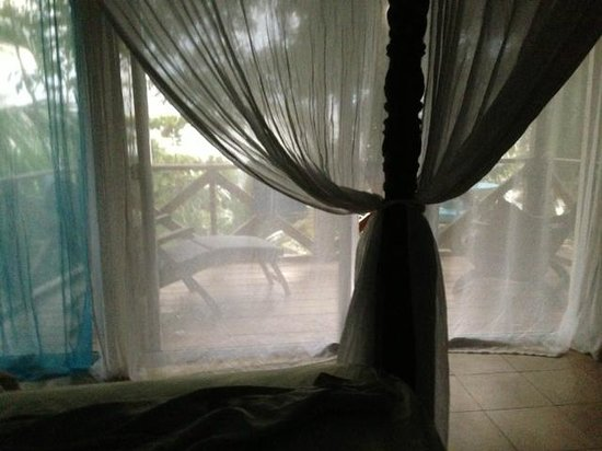 Popa Paradise Beach Resort:                   View from the bed to the ocean.