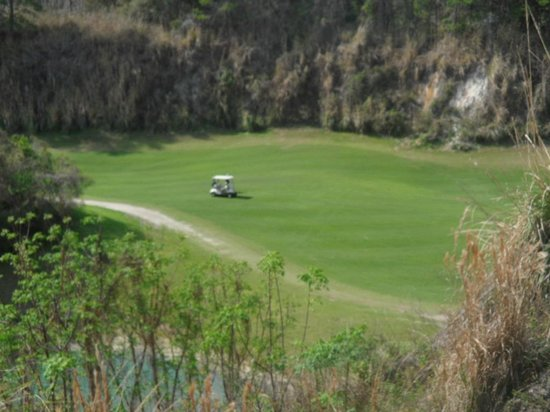 Brooksville Country Club:                   #13, looking down on cart approaching the green