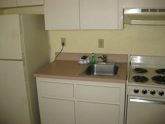 La Playa Resorts & Suites: Kitchen with stove, cabinets, sink, and full fridge