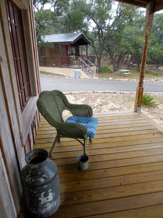 Tonkawaya Ranch B&B:                   Porch of little White House Cabin and View on other Cabins