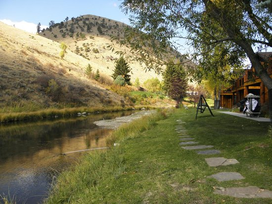 Rustic Inn Creekside Resort and Spa at Jackson Hole:                   Walkway along stream
