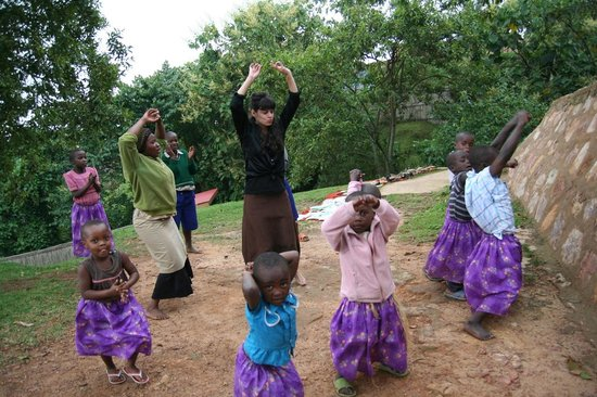 Nkuringo Bwindi Gorilla Lodge:                   dancing with children and Nkuringo