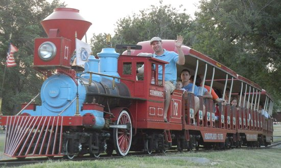 Enid, OK:                   Children and adults alike enjoy a ride around Meadowlake Park on the Kiwanis T