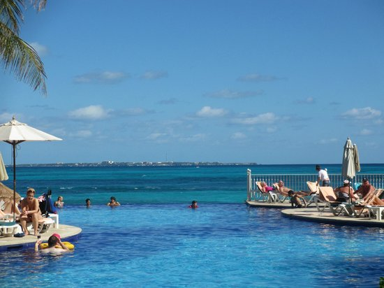 Hotel Riu Cancun:                                                       Second pool and Isla Mujeres at the horizo