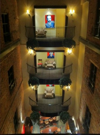 Hotel Nelligan:                   Looking into the indoor courtyard from the hallway, at night.