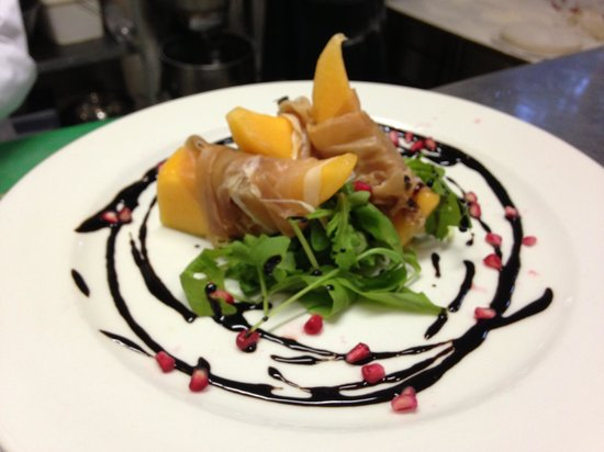 Reef and Dune :                   Fresh melon and Parma Ham on wild Rocket