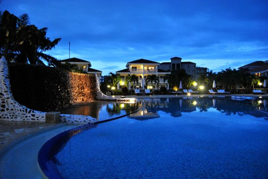The Placencia Hotel and Residences:                   Grounds at dusk/pool