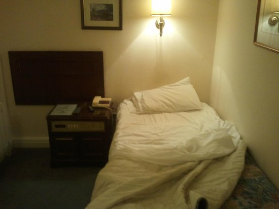 The Sitwell Arms Hotel:                   Room 1 - Single bed with headboard opposite on wall??
