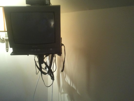 The Sitwell Arms Hotel:                   Room 2 - Broken TV with 4 way gang taped to tv bracket and loose wires