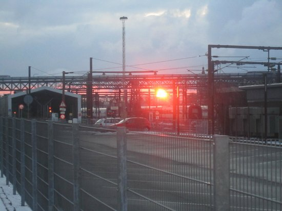 Wakeup Copenhagen Carsten Niebuhrs Gade:                   Sunset through the railway tack overhead cables.