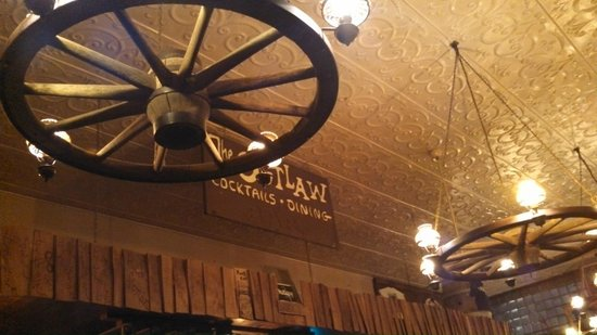 Outlaw Restaurant:                   Lights and sign over the bar