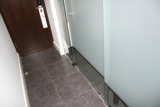 The Beacon:                                     Glass 'wall' between bedroom and bathroom.