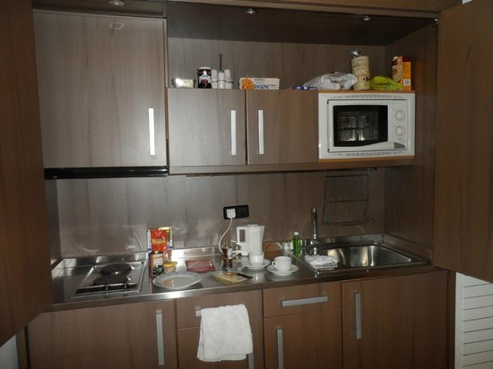 St. Jordi Apartments:                   Kitchen area - with doors that closed to shut it off if wanted