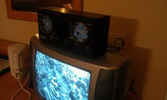 Claymore Hotel:                   antiquated CRT TV and bizarre alarm/radio