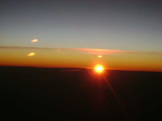 Martha's Bed and Breakfast:                   Amazing sun rise from airplane