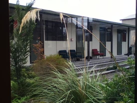 Stewart Island Backpackers :                   some of the rooms, exterior view