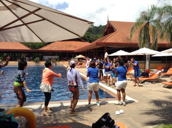 Club Med Cherating Beach:                   noon time dancing beside the pool