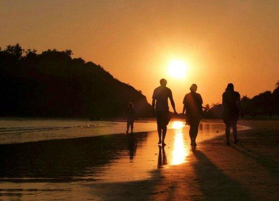 Big bamboo bar and restaurant:                                                       take a walk along the beach at sunset