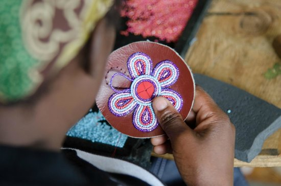Naivasha, Kenya:                   Beading a flower keyring