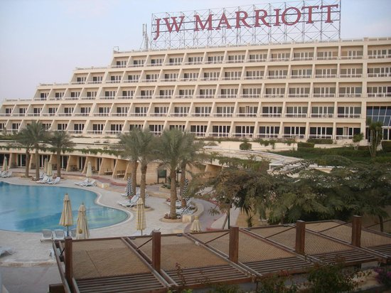JW Marriott Hotel Cairo:                                     View of outdoor pool with hotel in background