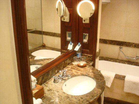 JW Marriott Hotel Cairo:                                     bathroom sink with tub in background