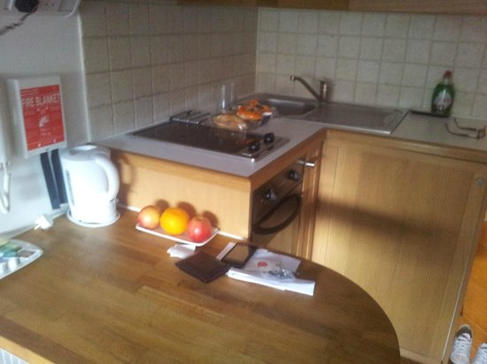 Studios2Let Serviced Apartments - Cartwright Gardens:                   Breakfast bar with kettle, oven, sink and toaster stored away.