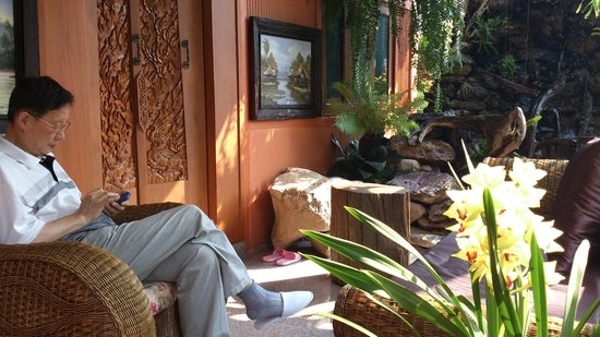 Oriental Siam Resort:                   Papa in front of their room/villa