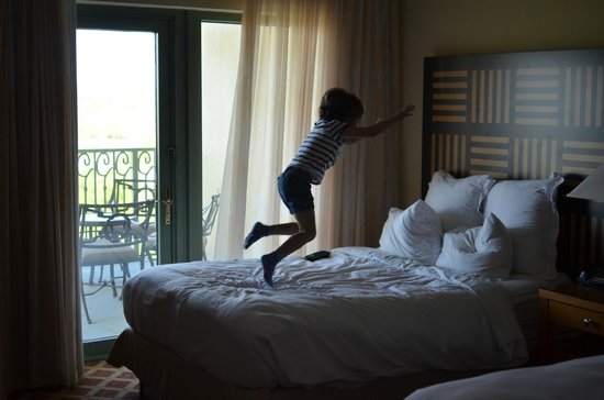 The Renaissance World Golf Village Resort:                                     Child Jumping on super soft bed